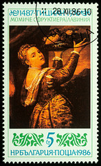 """Painting """"Girl with a tray of fruit"""" by Titian on postage stamp"""