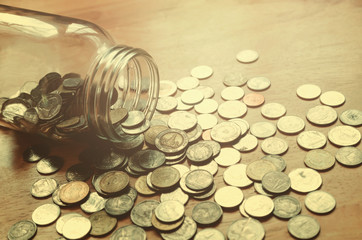 saving money in jar glass, concept finance with filter effect retro vintage style