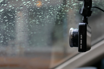 small video camera record inside motor vehicle on windshield, drive car road trips in rainny day weather