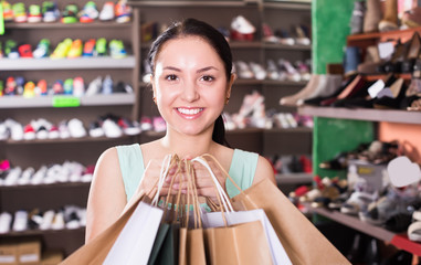Attractive woman is showing her purchases