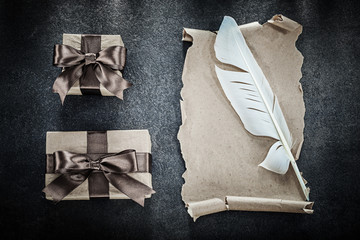 Vintage paper scroll plume gift boxes on black background