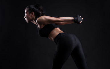 Asian sporty woman with Arms Pain,on a black background,sport,fitness, bodybuilding,healthy and lifestyle concept.