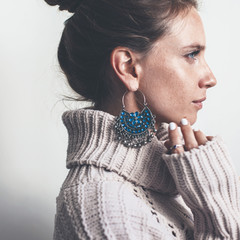 Boho jewelry and woolen sweater on model