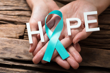 Hand Showing Ribbon With Hope Text