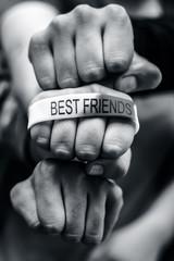 hands of three best friends.
