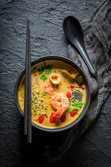 Closeup of Tom Yum soup on black rock