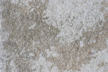 Abstract texture of old cement wall with stained and shabby uneven plaster vintage background