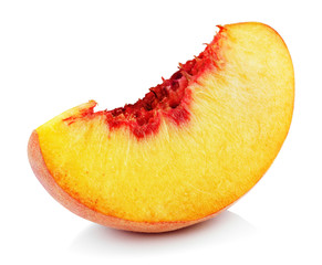 Slice of ripe peach fruit isolated on white background. Peach slice with clipping path