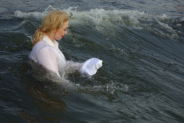 business woman floating in the sea with paper sheets