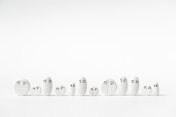 Funny white tablets in a row, various shapes, 12 pieces, white background,