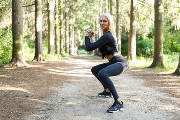 Picture of sportswoman doing exercise on squatting