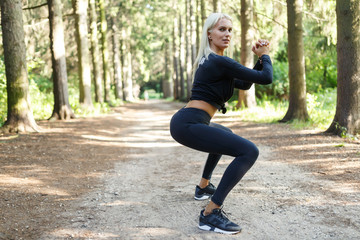 Photo of athlete performing exercise on squatting