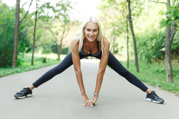 Photo of sports girl stretching in park