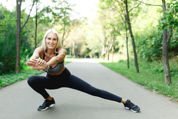 Image of sports girl stretching in park