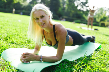 Picture of sports blonde performing exercise