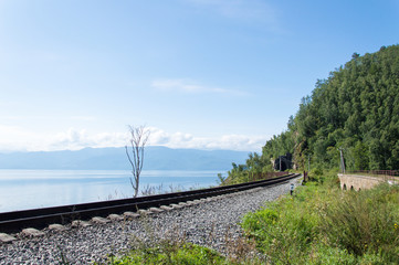 Rails in front of idyllic landscape of Lake Baikal, Siberia, Russia - on a day in summer 2017