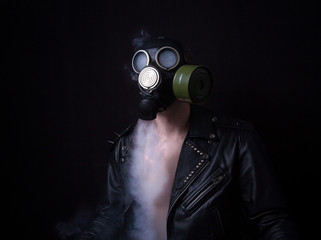 post apocalypse. portrait of men in gas mask in leather jacket