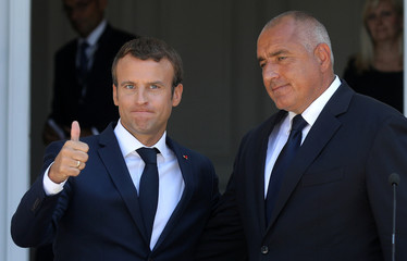 Bulgarian Prime Minister Boyko Borissov and French President Emmanuel Macron react at the end of a joint news conference at Euxinograd residence