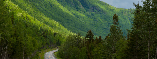 Poster Hill Driving through a mountain range in Gaspe, Quebec