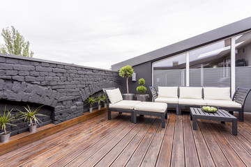 Terrace with black brick wall
