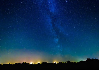 Milky way and stars above the village.