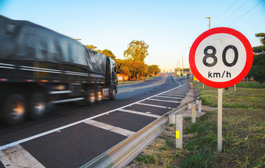 Big truck passing at high speed on road exceeding speed limits