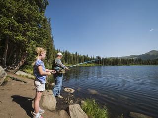 USA, Utah, Lake City, Girl (4-5) with grandfather fishing in lake