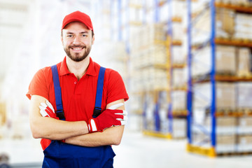 smiling young warehouse worker in red uniform. copy space