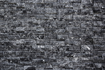 Backdrop of black brick wall texture.