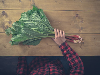 Man sitting at table with rhubarb