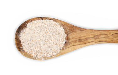 Pile of integral spelt wheat flour in wooden spoon isolated on white