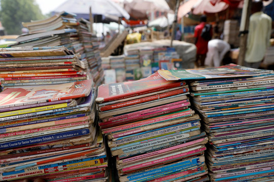 Used books are seen arranged for sale in a market at the farm centre district in Kano