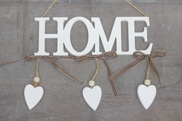 Beautiful Interior decorations  with HOME letters and hearts isolated on wooden and white background - close
