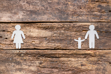 Paper family on a wooden background - a child with a father after a divorce