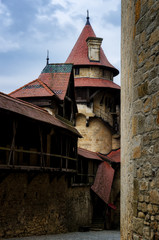 Medieval castle walls with battlements and defensive tower