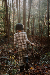 A young boy exploring the wilderness in the fall