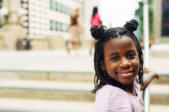 Black girl on a sidewalk