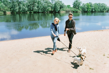 Couple walk with his dogs