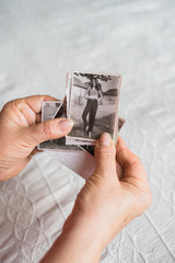 Woman Looking at Old Photographs