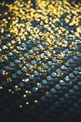 Golden stars on ta textured background