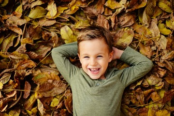 Boy is playing with leaves