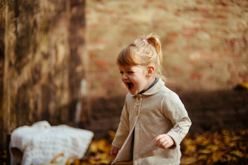 Girl is playing with leaves