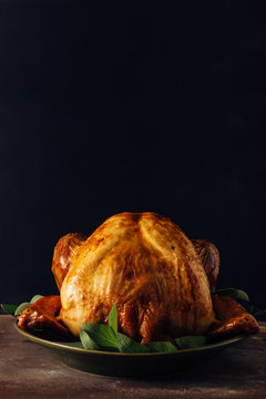 Roasted turkey on a plate with sage
