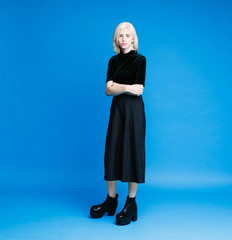 Sensual blonde woman posing wearing massive boots