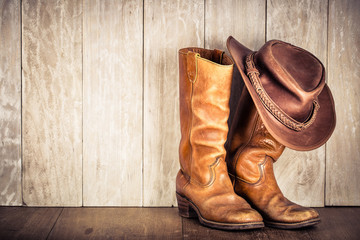 Wild West retro leather cowboy hat and old boots. Vintage style filtered photo
