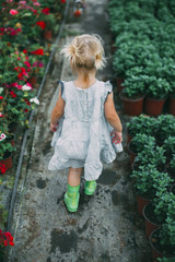 Back view of a little girl captured in the greenhouse