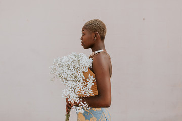 Beautiful african american woman with bouquet of gypsophila