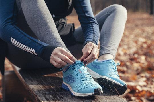Woman tying a shoe lace