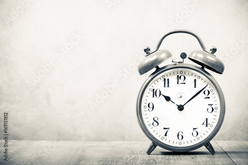 Old Retro Alarm Clock On Wooden Table Vintage Style Sepia Photo