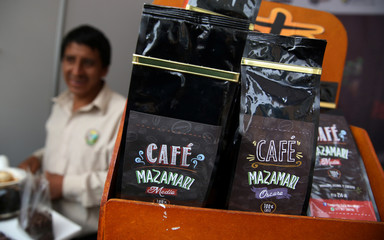 Bags of coffee Mazamari are display for sale at a stand at the Coffee Fair in Lima,